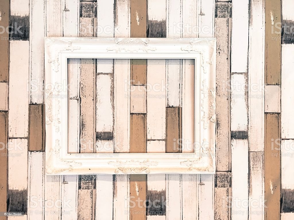White wooden picture frame/border hang on the wooden wall royalty-free stock photo