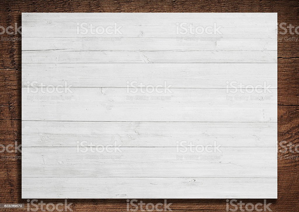 White wooden planks, billboard fixed on brown board stock photo