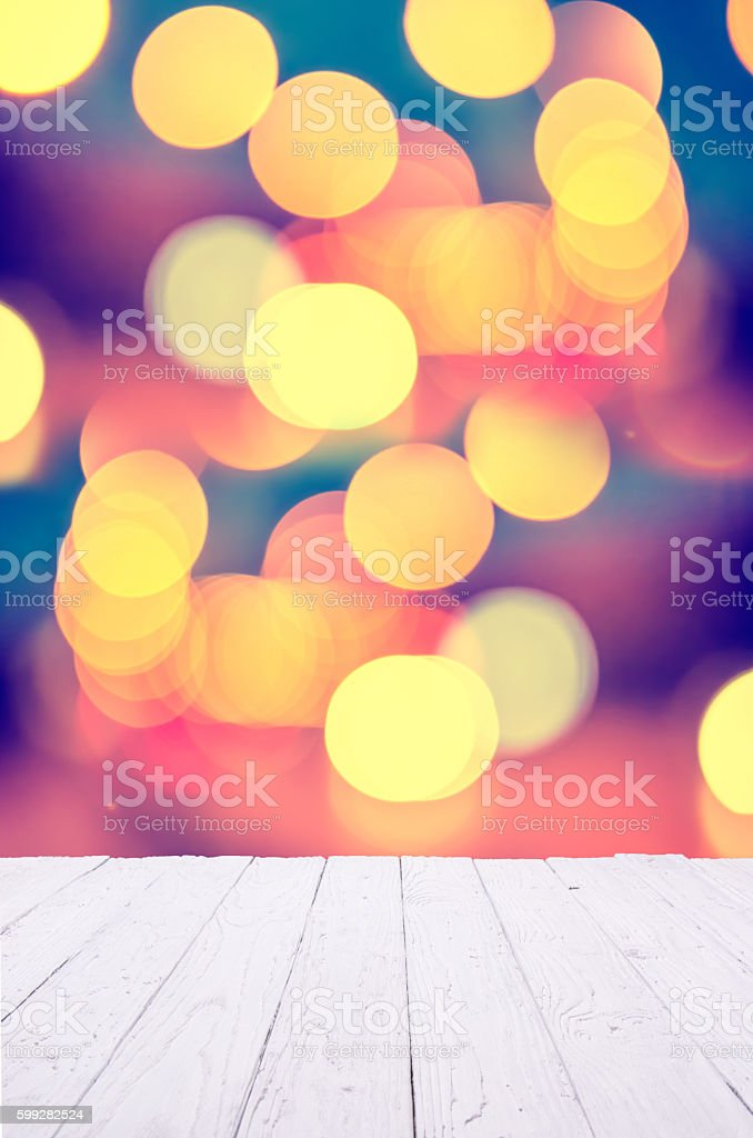 White wooden table with colorful bokeh background stock photo