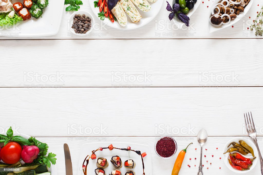 White wooden table with traditional food frame stock photo