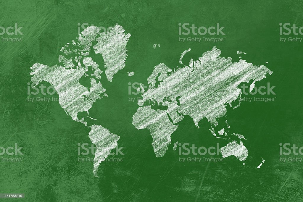 White world map on a blackboard inside a class royalty-free stock photo