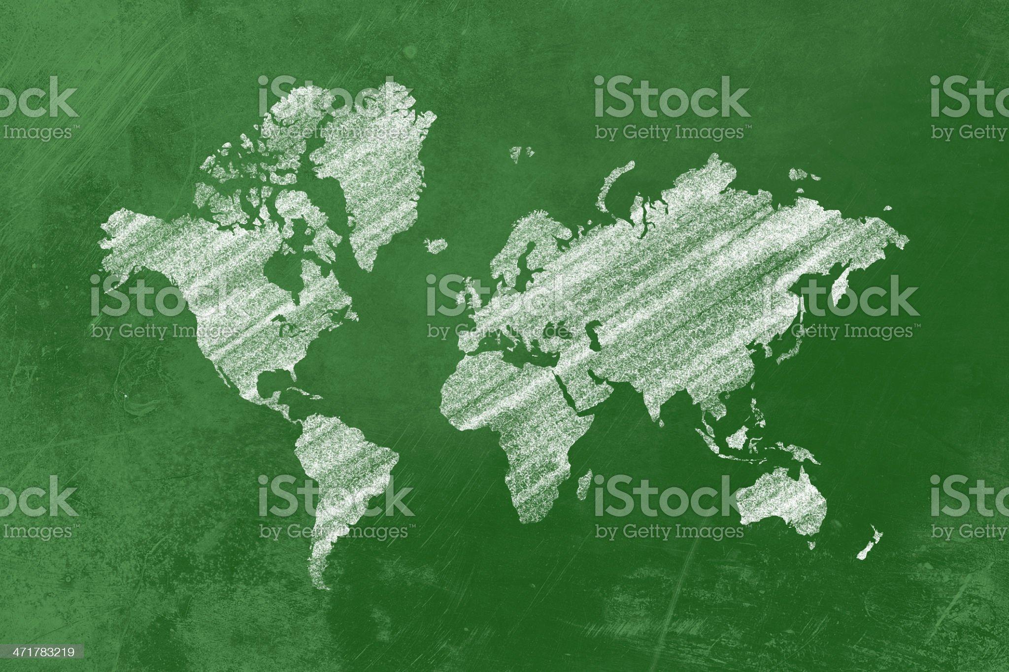 White world map on a blackboard inside a class royalty-free stock photo