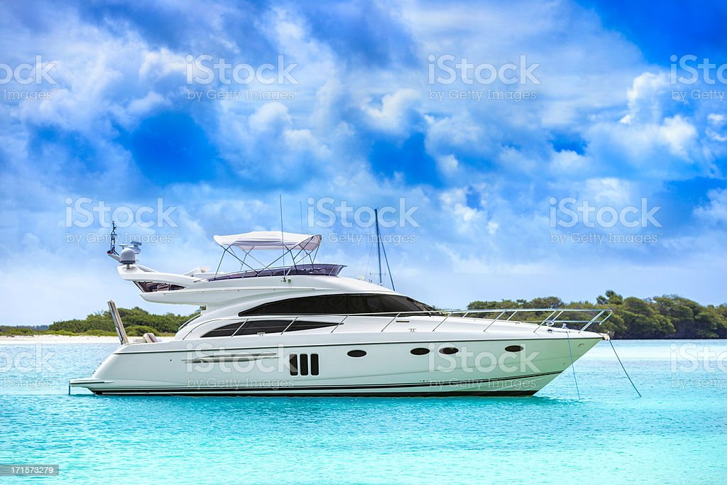White yacht in the middle of the water stock photo