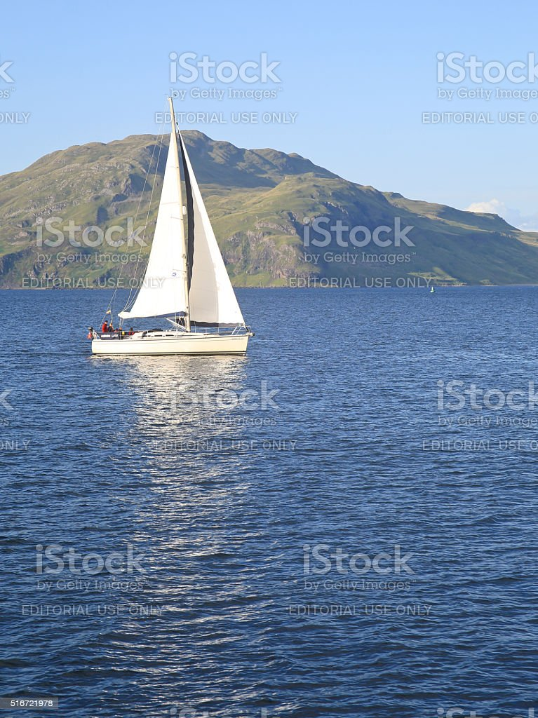 White Yacht Sailing on the Sound of Mull, Scotland, UK. stock photo