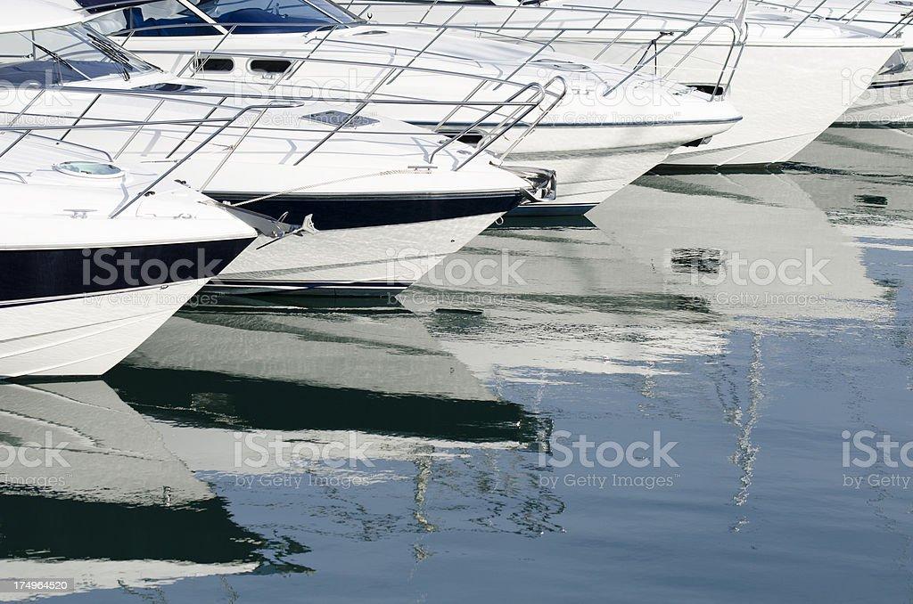 White Yachts in a row at marina royalty-free stock photo