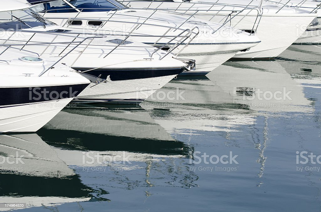 White Yachts in a row at marina stock photo