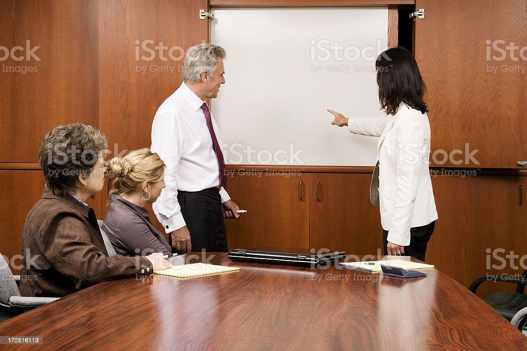 Whiteboard Meeting in Progress royalty-free stock photo