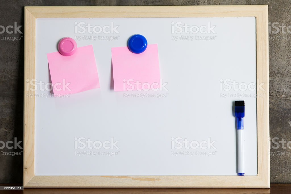 Whiteboard with marker and memo note stock photo