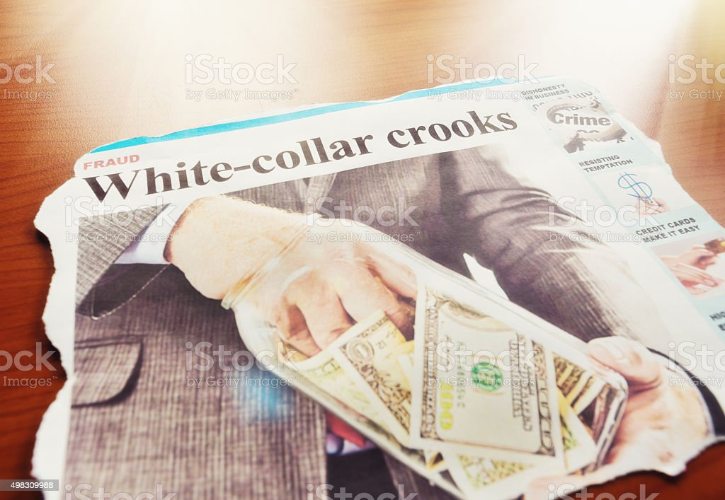 White-collar crime newspaper article: businessman taking money from cookie jar stock photo