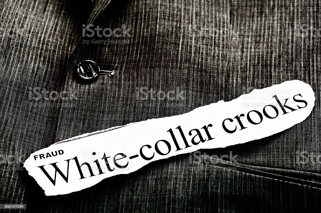 White-collar crooks and fraud in headlines placed on suit jacket stock photo