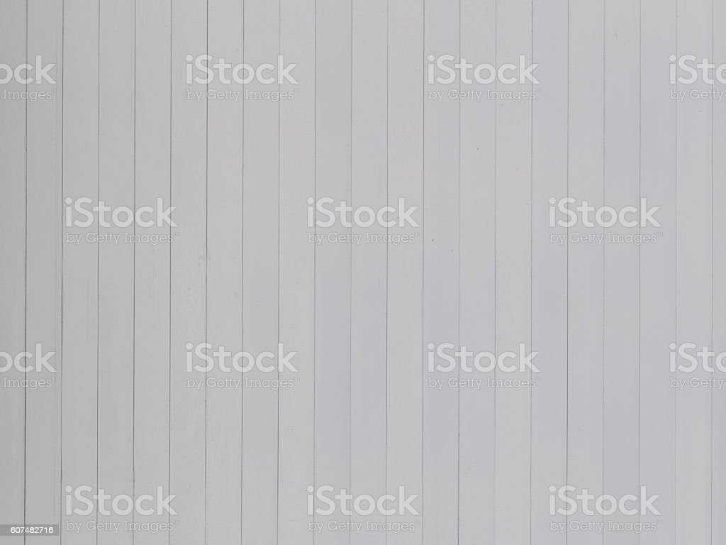 white-gray wall of painted boards stock photo