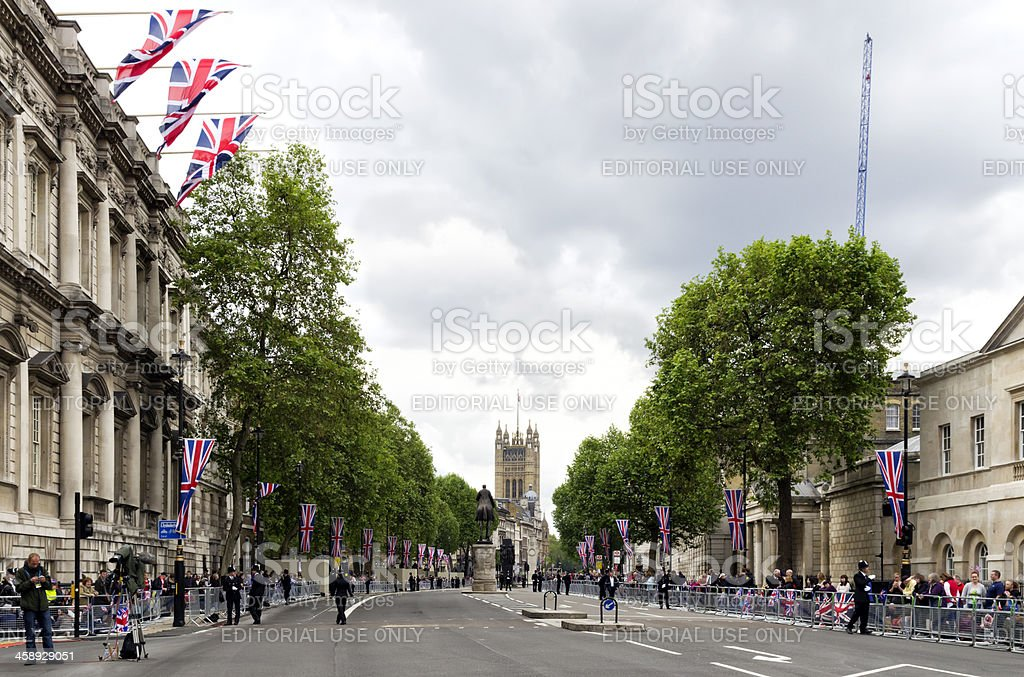 Whitehall with Union Jacks and crowds royalty-free stock photo