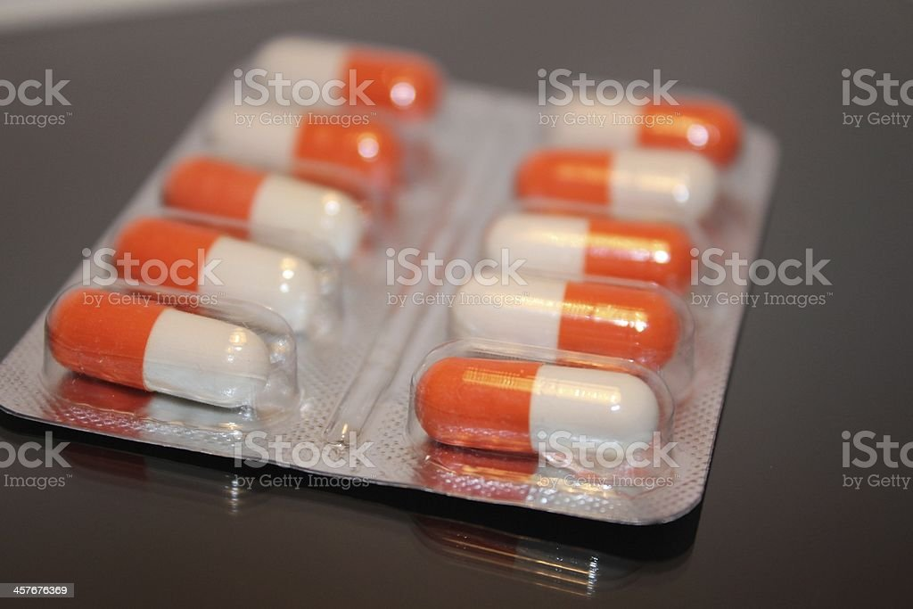 White-orange medical pills royalty-free stock photo