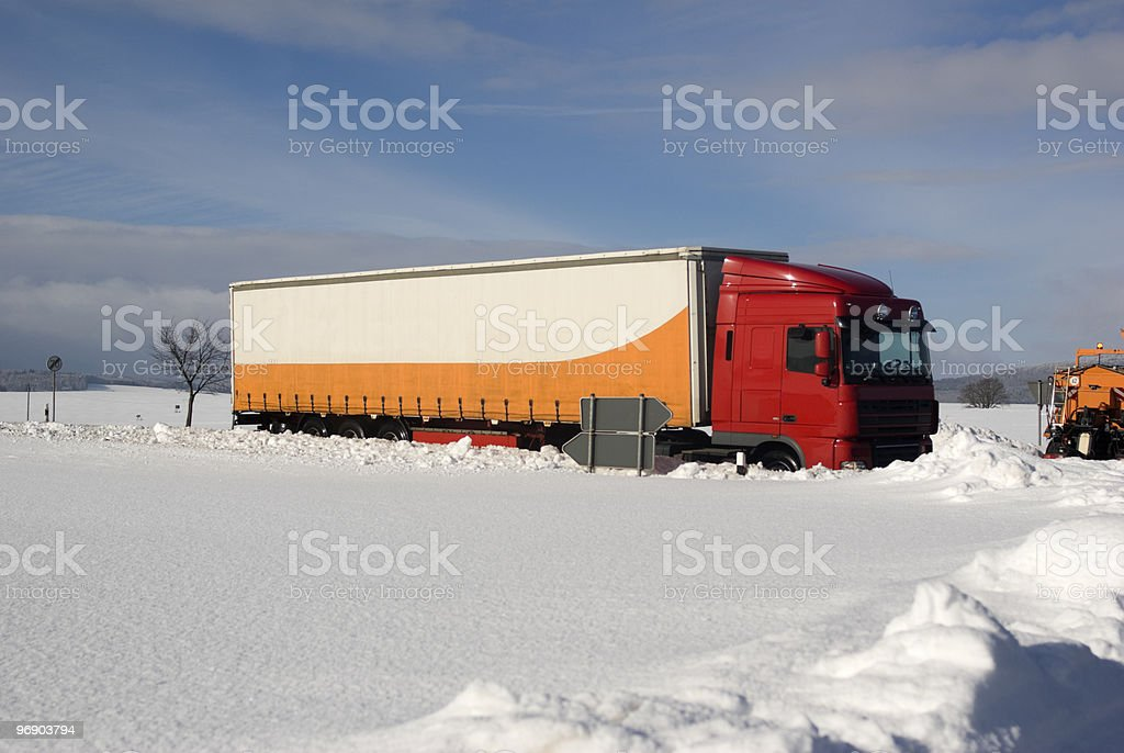 White-orange truck on the Federal road in winter stock photo