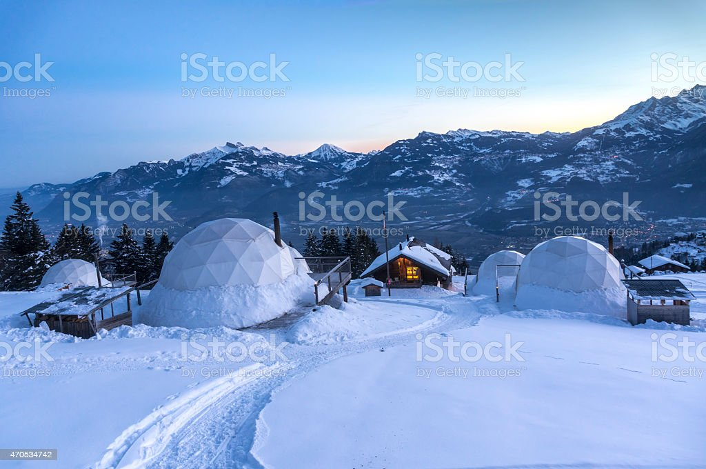 Whitepod winter igloos stock photo