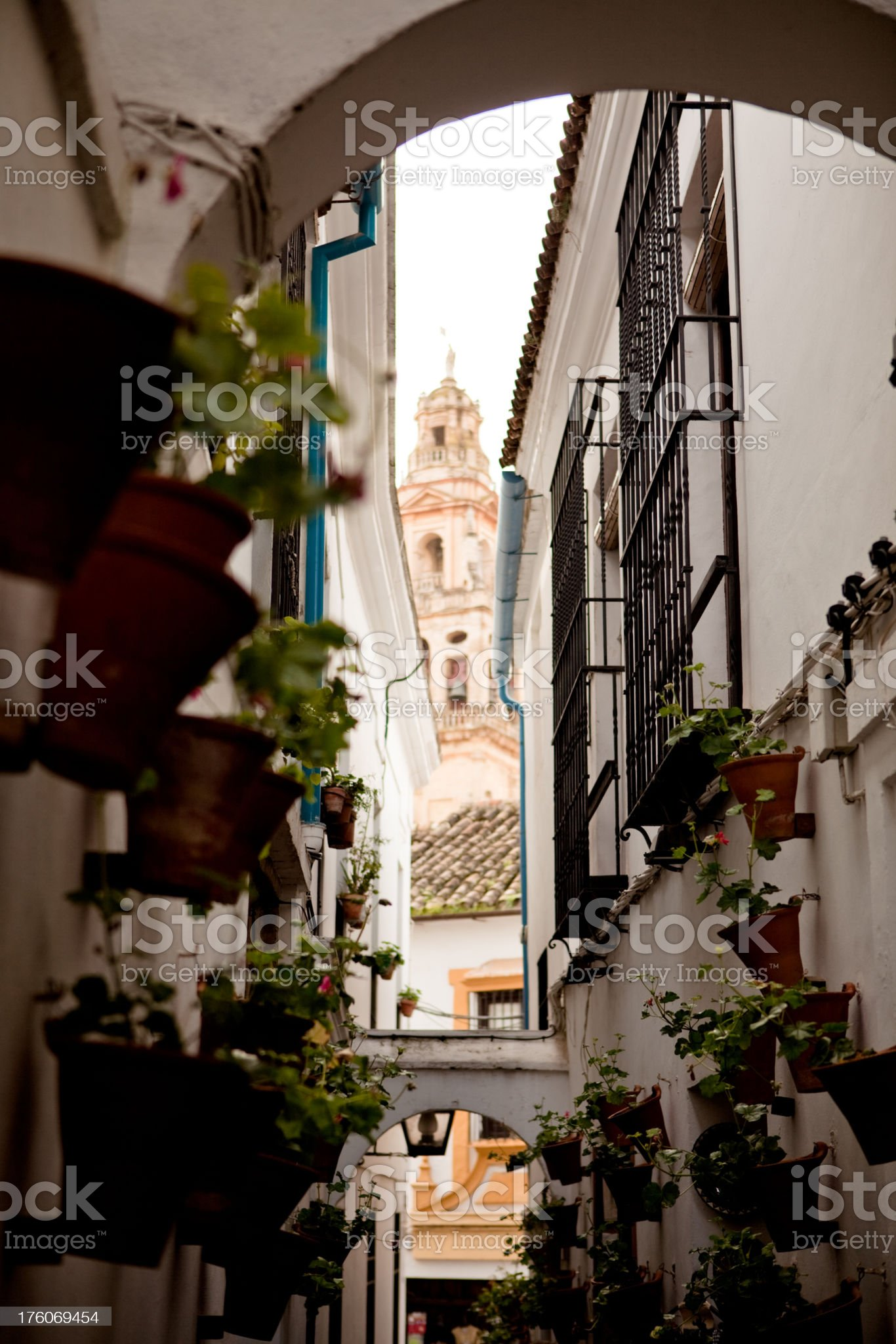 Whitewashed alley in Cordoba Spain royalty-free stock photo