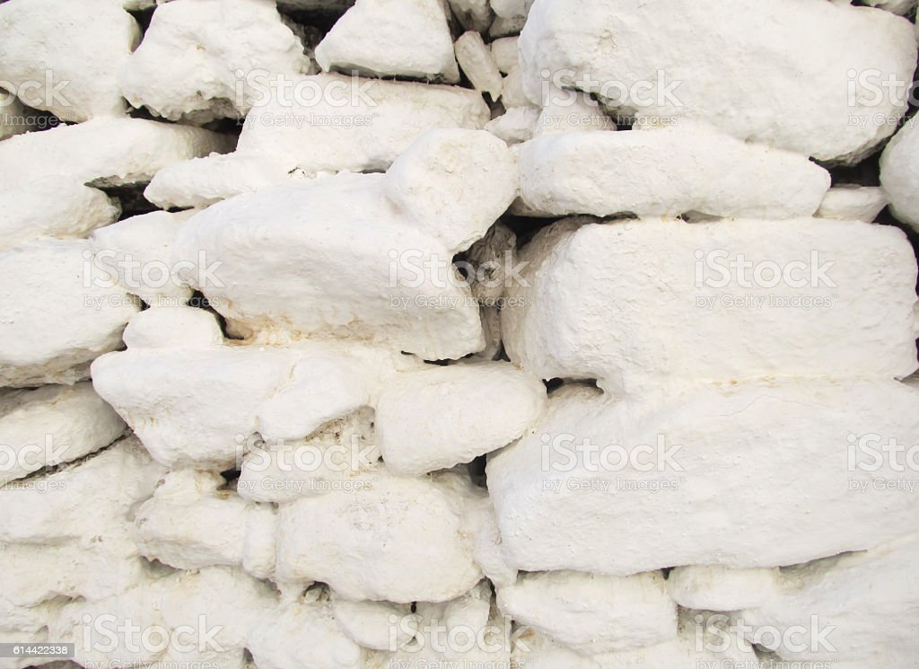 Whitewashed dry stone wall stock photo