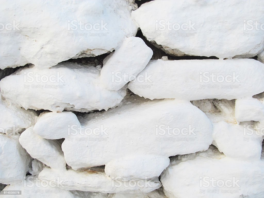 whitewashed stone wall stock photo