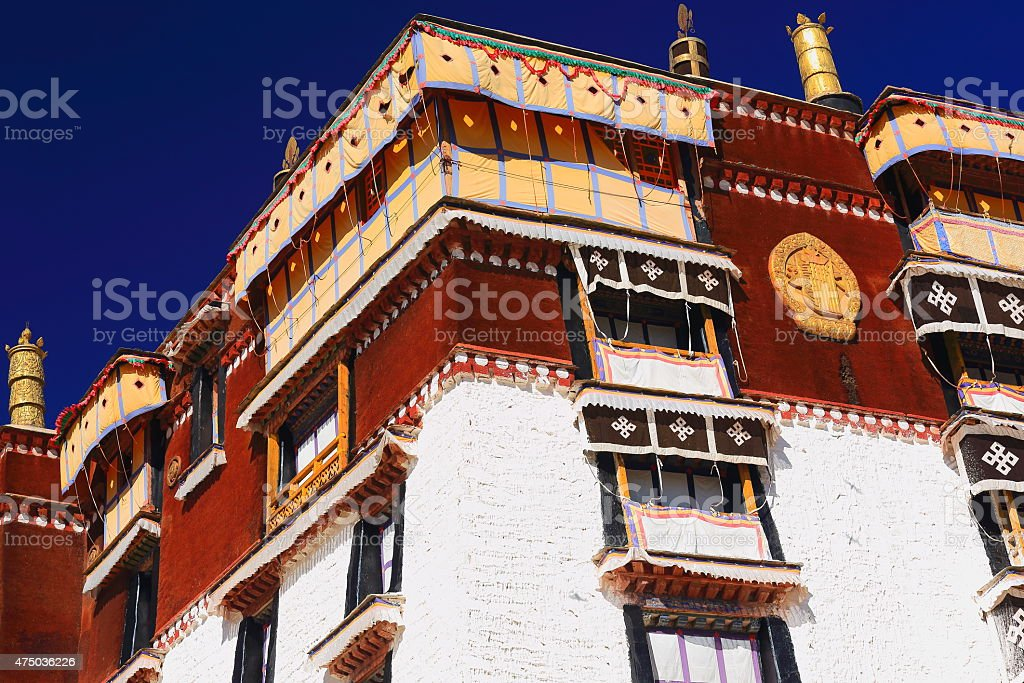 Whitewashed wall-gilded and wooden dhvajas. Potala-Lhasa-Tibet. 1395 stock photo