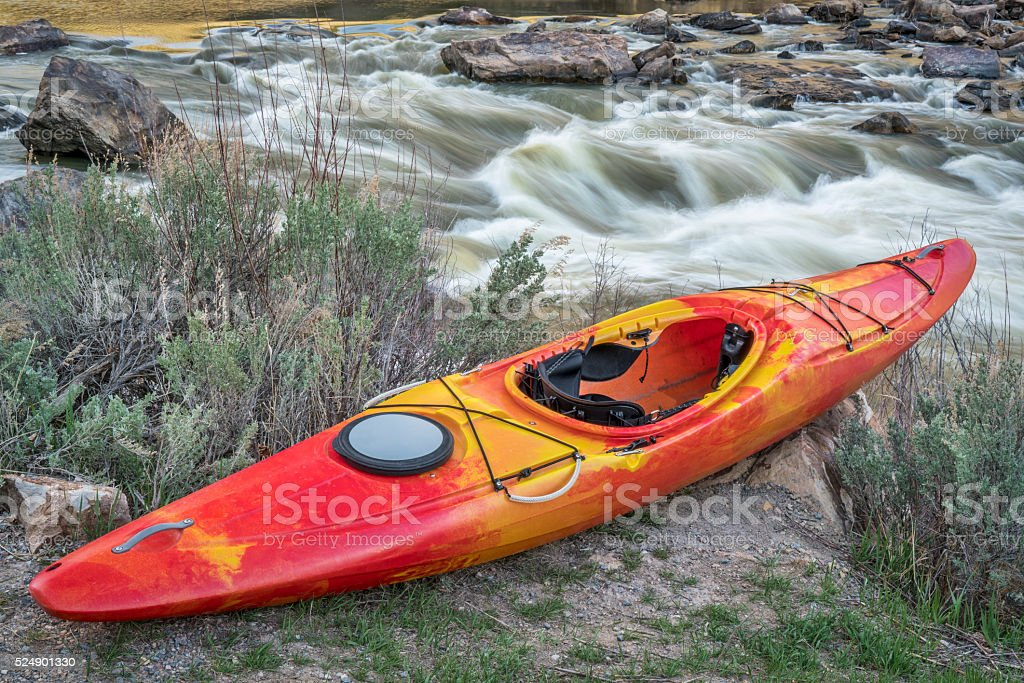whitewater kayak and river rapid stock photo