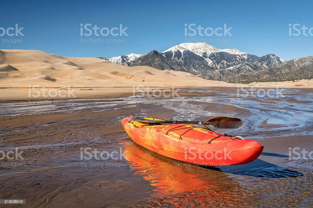 whitewater kayak in shallow water stock photo