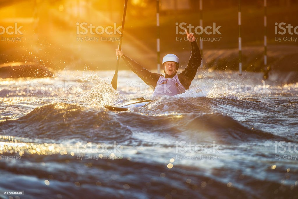 Whitewater kayaking winner stock photo