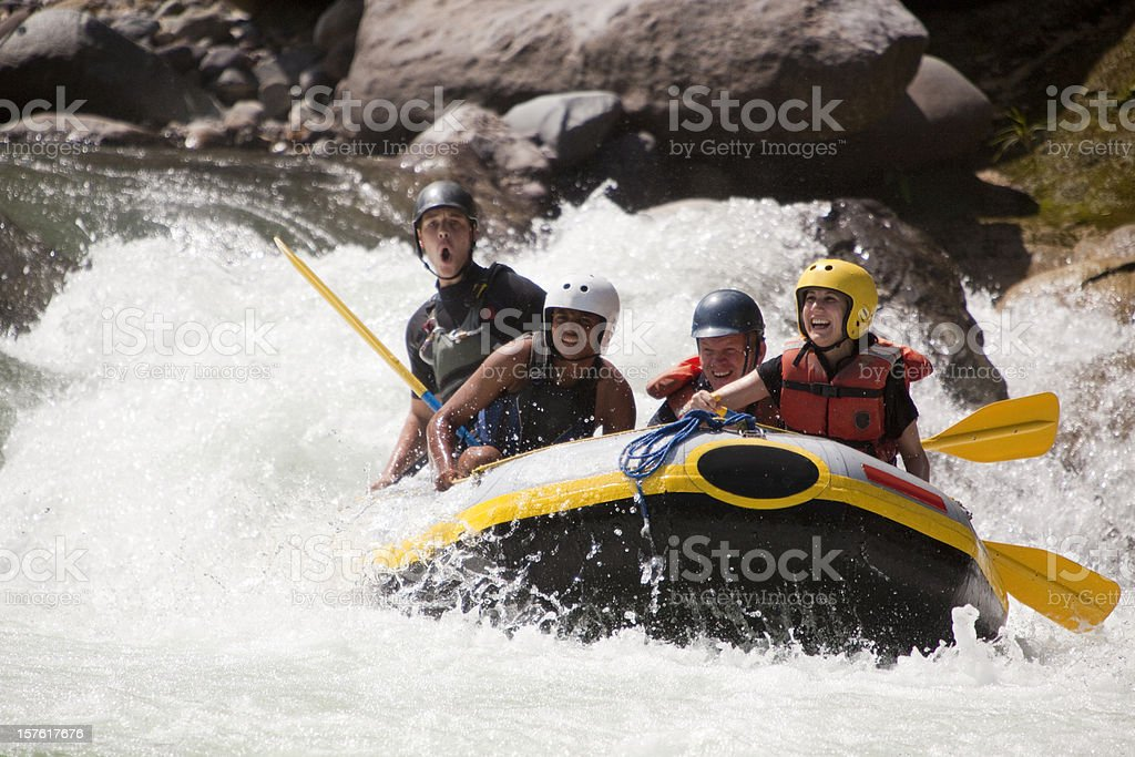 Whitewater rafting through rapids stock photo