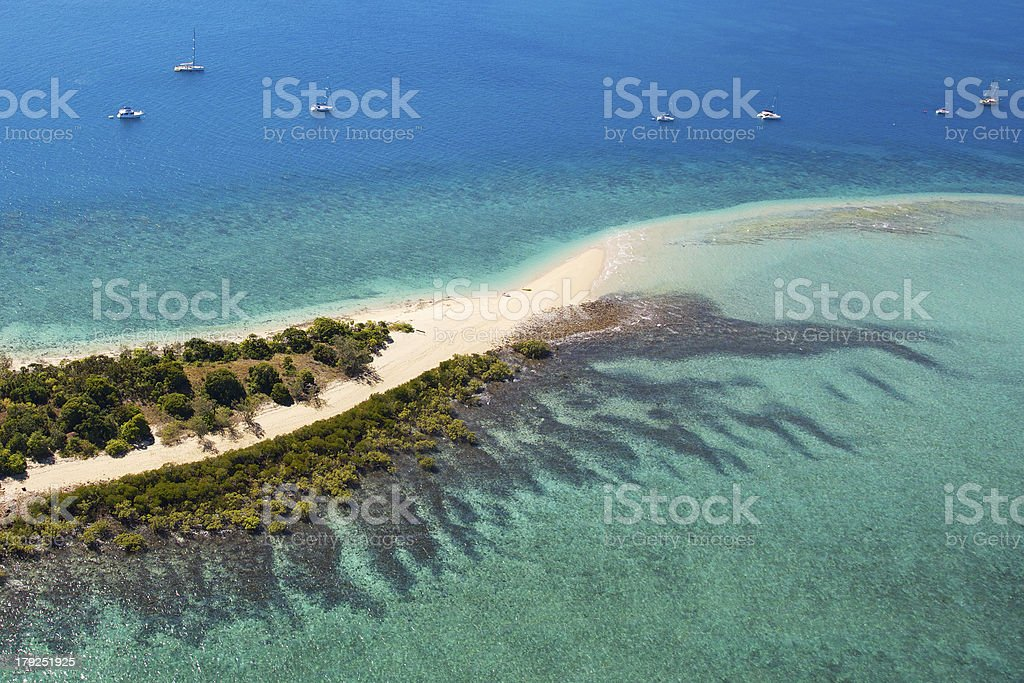 Whitsunday Island surrounded by reef stock photo