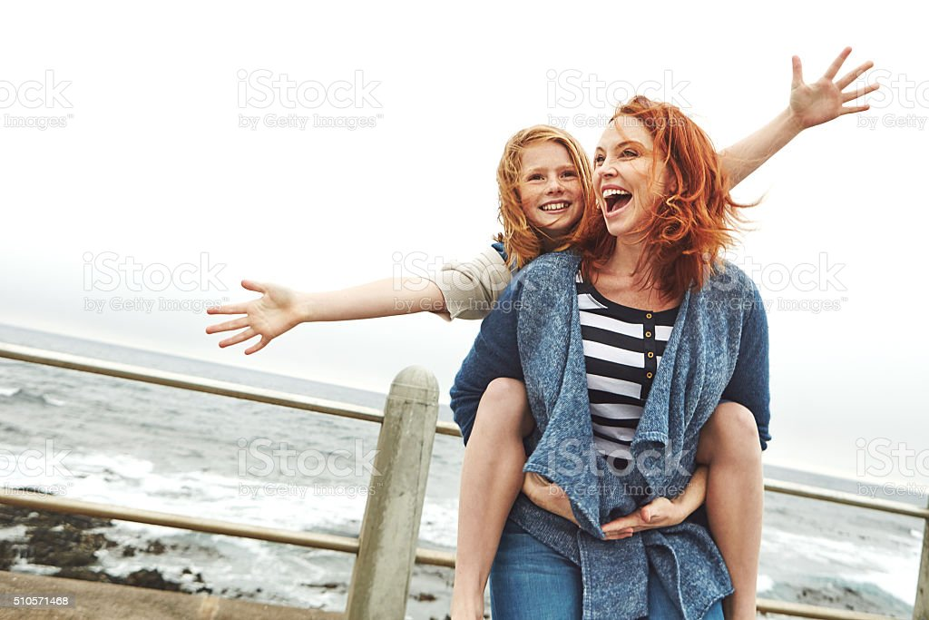 Who doesn't like a good piggyback ride stock photo