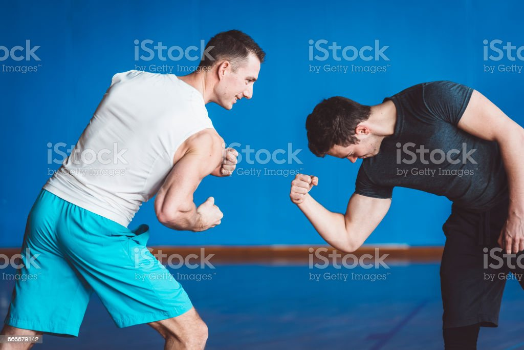 Who Has a Bigger Biceps? stock photo