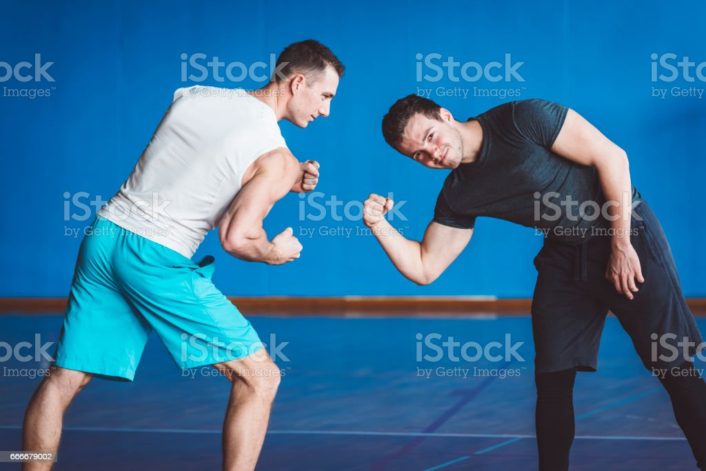 Who Is Stronger? Who Has a Bigger Biceps? stock photo