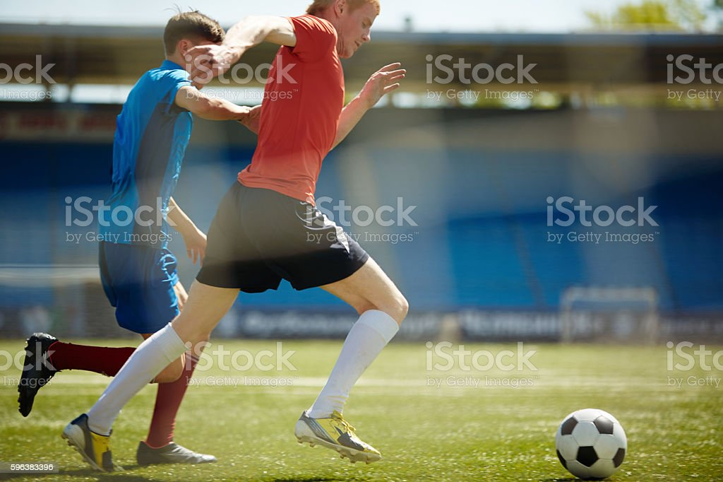 Who is the first to take the ball stock photo