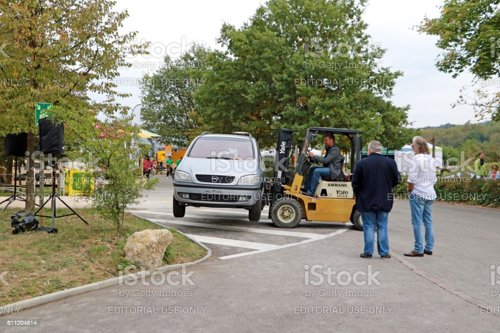 Who needs a tow truck when one has a forklift? stock photo