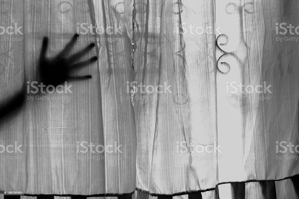 Who the hand behind the curtain. happy Halloween stock photo