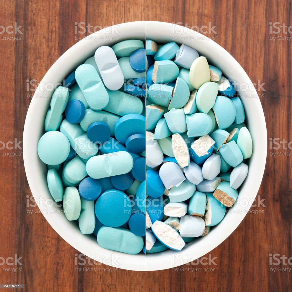 Whole and broken blue pills composition stock photo