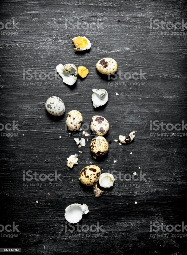 Whole and broken quail eggs. stock photo