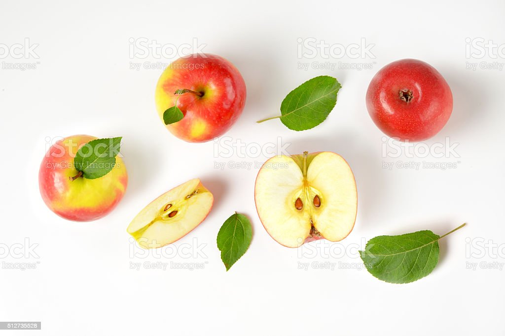 whole and cut apples stock photo