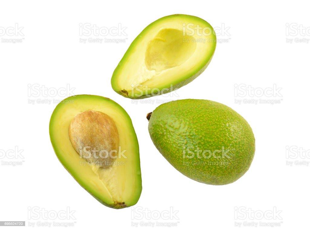 Whole and cut avocado fruit stock photo