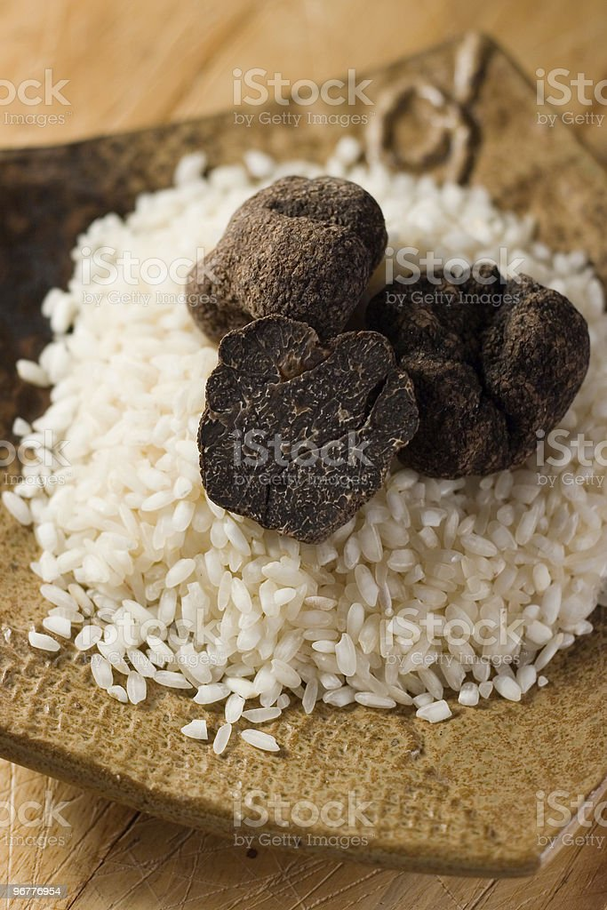 Whole and Cut Black Truffles royalty-free stock photo