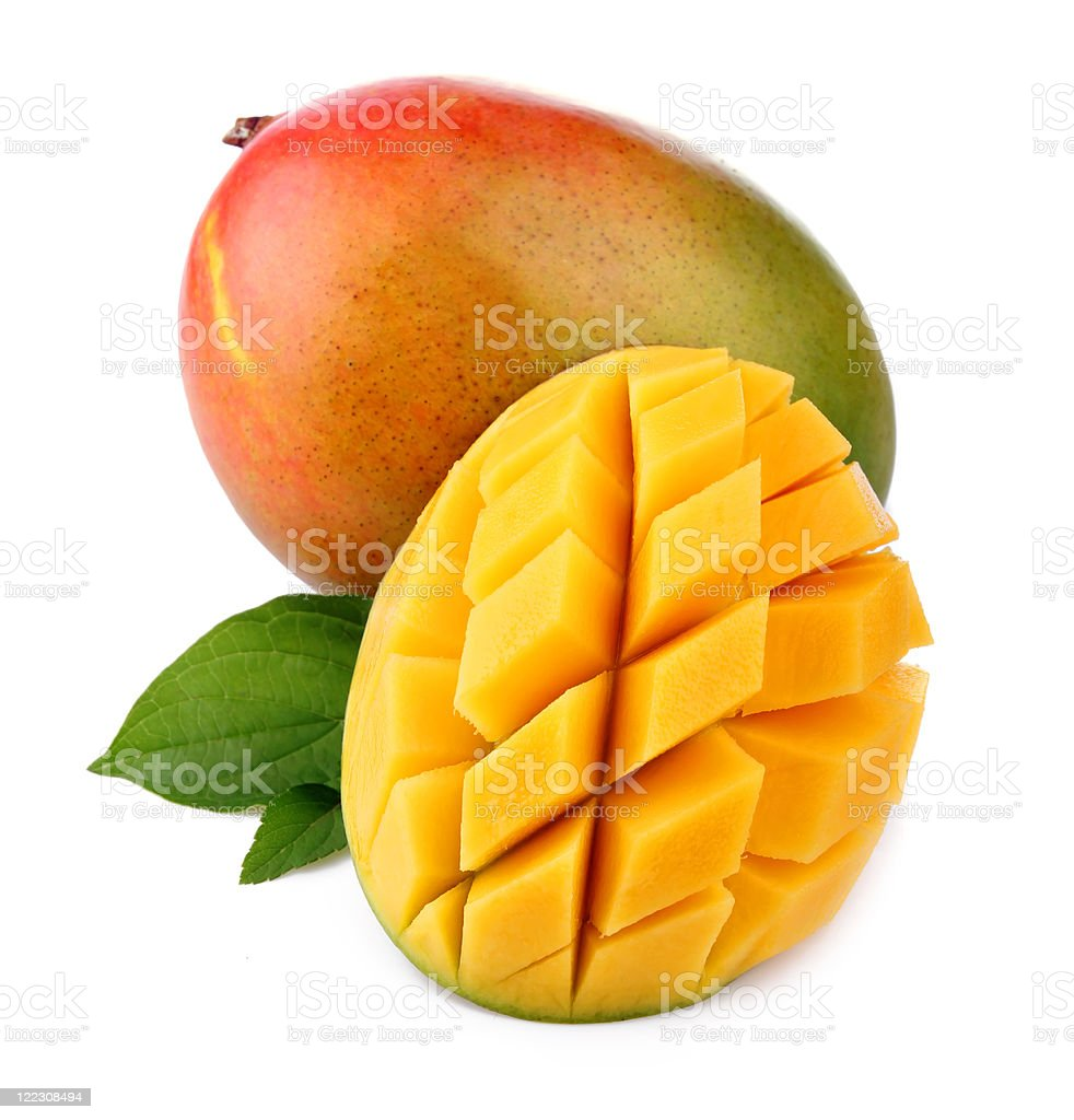 A whole and cut fresh mango on a white background royalty-free stock photo