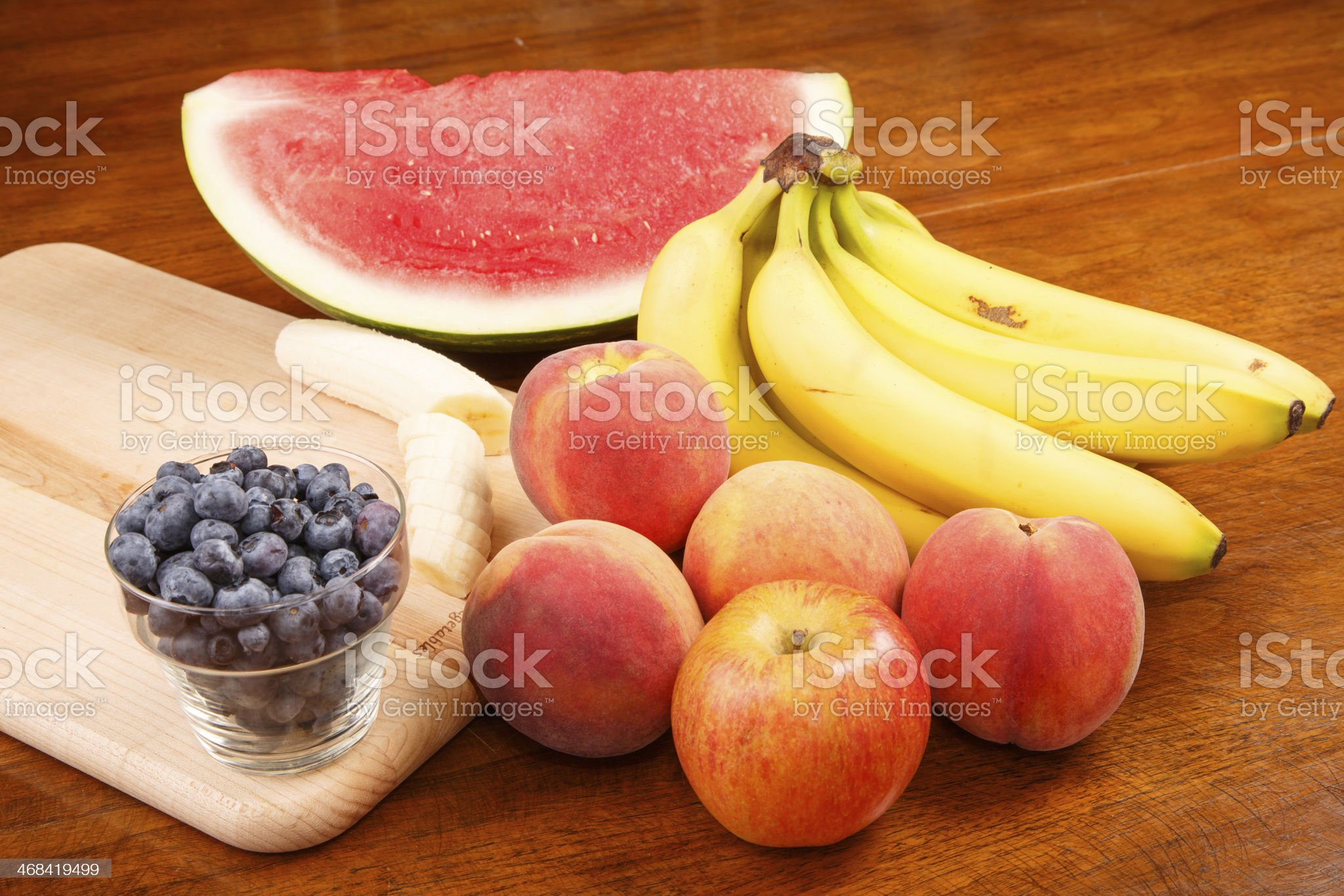 Whole and Cut Fruit on Table royalty-free stock photo