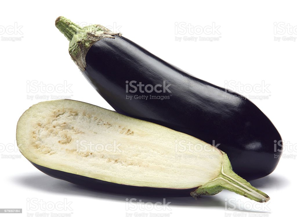 A whole and cut in half eggplant stock photo