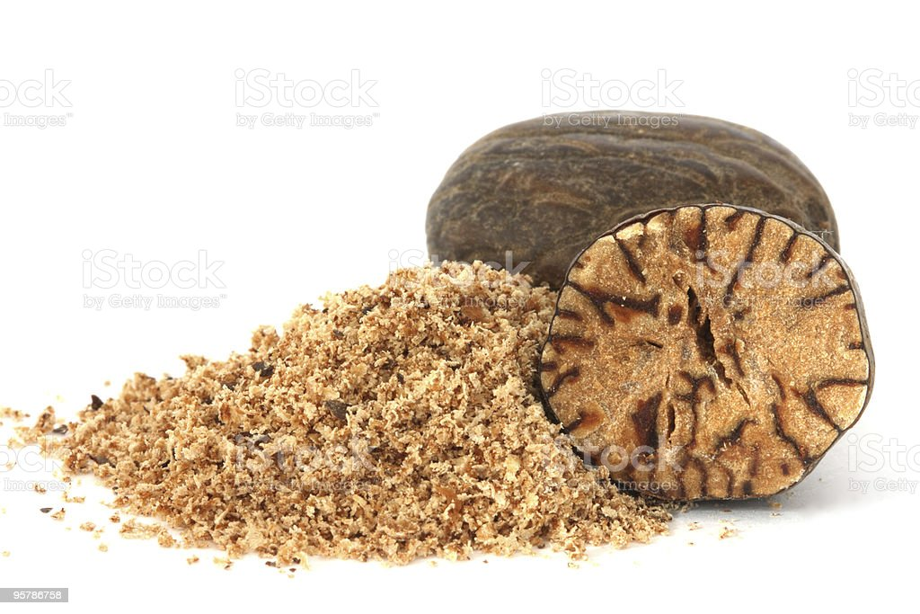 Whole and grated nutmeg closeup stock photo