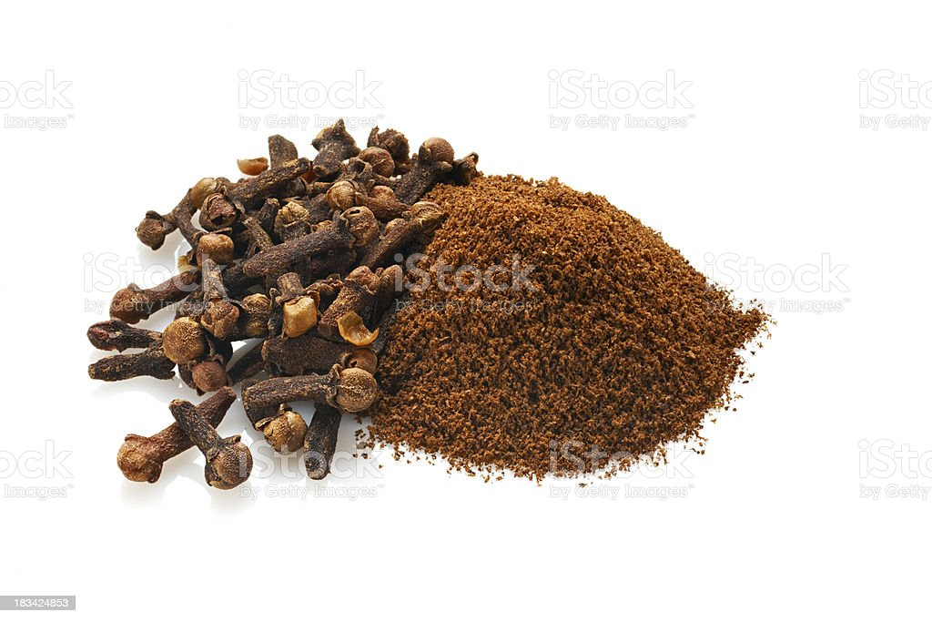 Whole and Ground Cloves, Isolated on White royalty-free stock photo