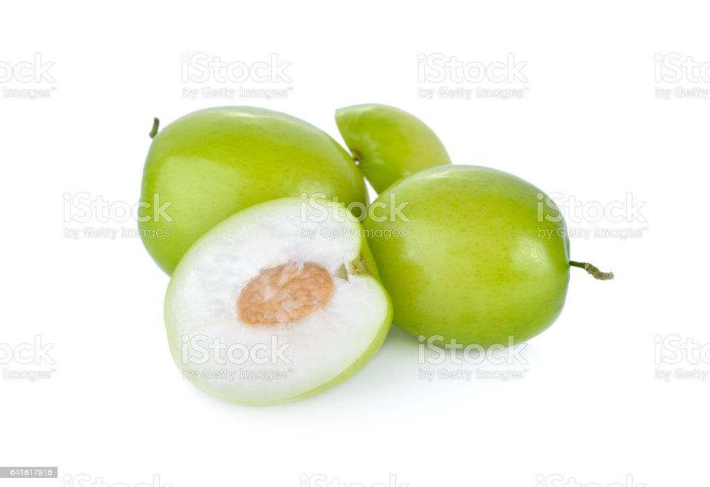 whole and half cut fresh jujube on white background stock photo