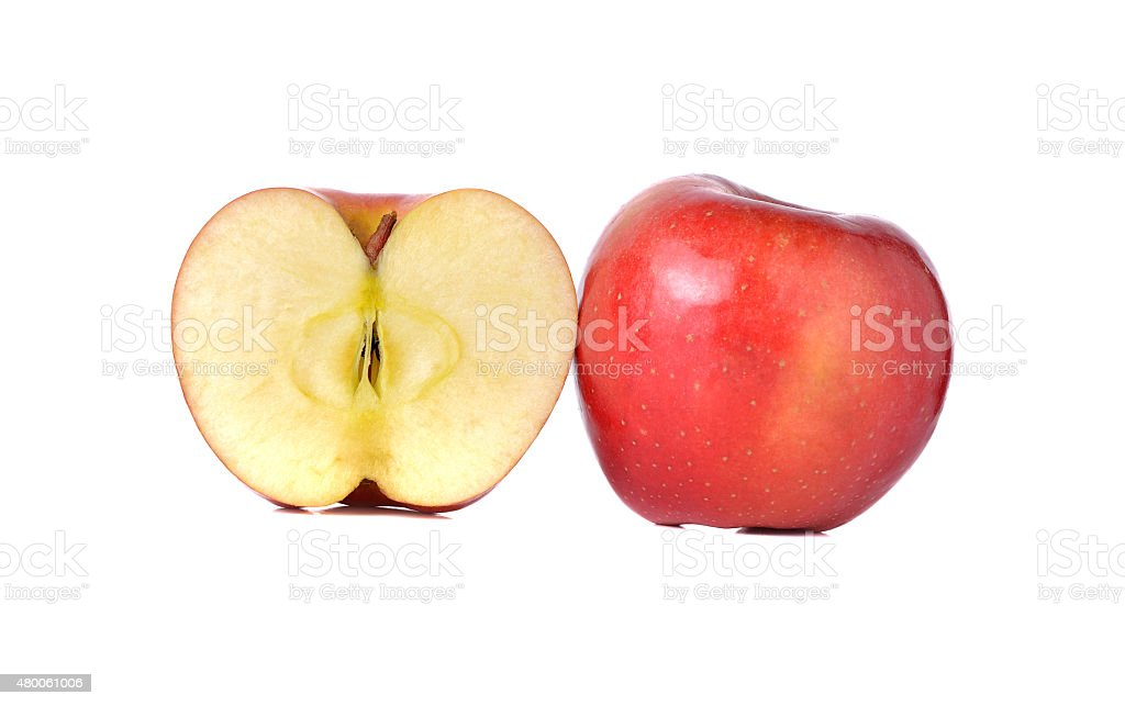 whole and half cut red apples with stem on white stock photo