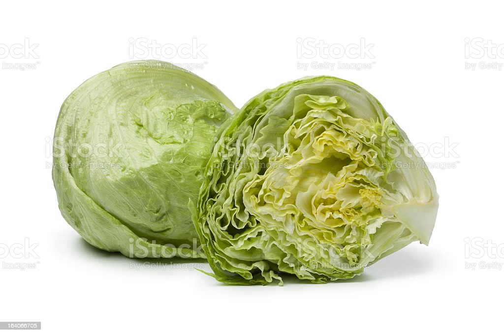 Whole and half Iceberg lettuce stock photo