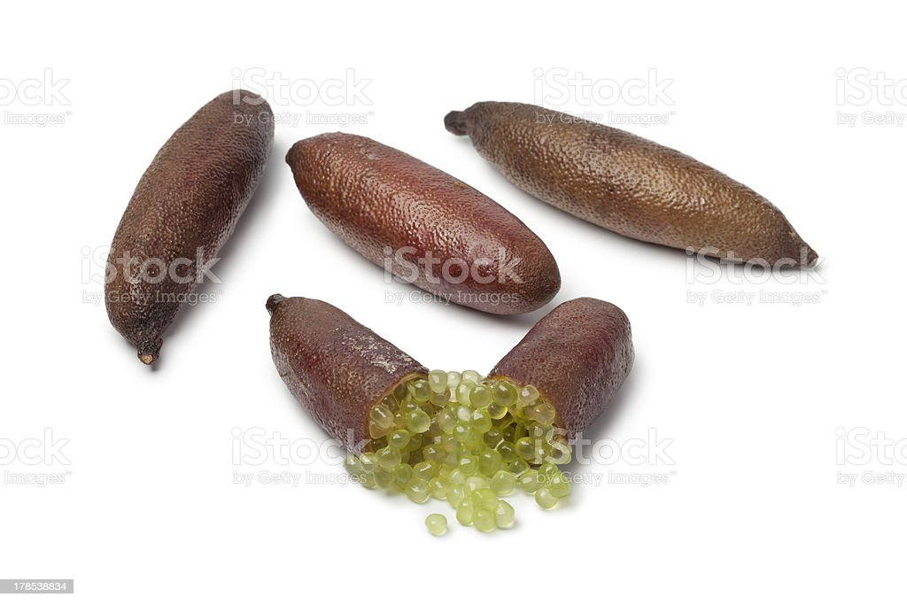 Whole and half lime fingers stock photo