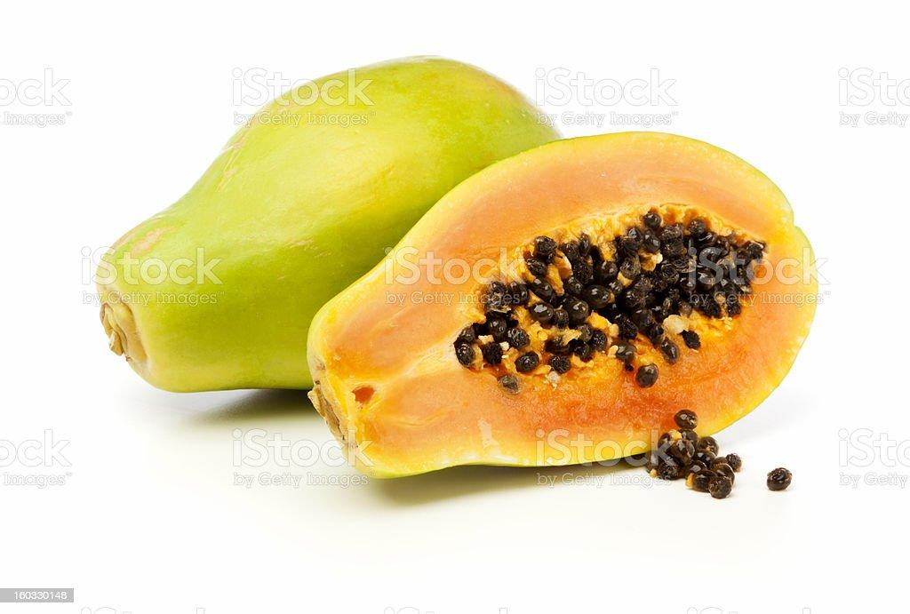 Whole and half Papaya fruit isolated stock photo