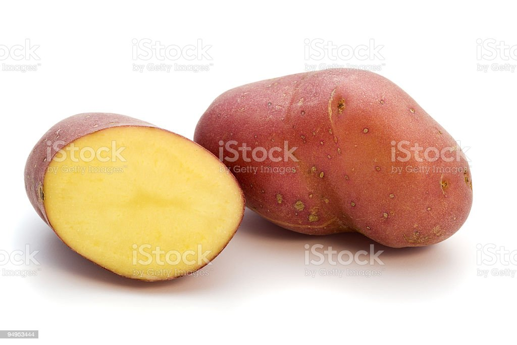 whole and half red miniature potato royalty-free stock photo